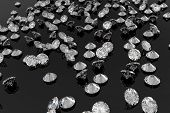 Lots of diamonds on a shiny black background