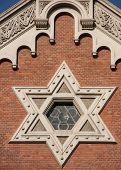 The star of David as central ornament of the Synagogue of Plzen.