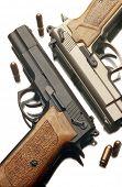two 9 mm handguns