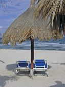 Two Chairs And Palapa On Beach