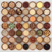 Dried macrobiotic super food with legumes, seeds, nuts, cereal, vegetables, grains and whole wheat p poster