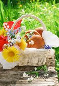 Basket With Patties And Flowers In The Garden