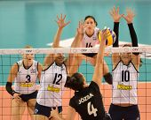 DEBRECEN, HUNGARY - JULY 9: Zsuzsanna Jozsa (in black 4) in action a CEV European League woman's volleyball game Hungary (black) vs Israel (white) on July 9, 2011 in Debrecen, Hungary.