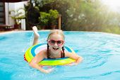 Child In Swimming Pool. Kids Swim. Water Play. poster
