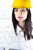 Engineer Woman In Yellow Helmet With Plans