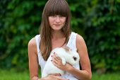 Teenage Girl Holding White Rabbit