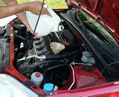 Adding Motor Oil To Car