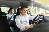 transport, vehicle and people concept - male driver driving car with passenger poster