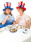 Two angry conservative voters having an actual tea party.  White background.  Room for text at the b