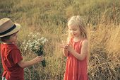 Adventure And Vacations Children Concept. Happy Children Girl And Boy Hug On Meadow In Summer In Nat poster