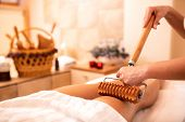Wooden Roller With Extended Handle Applied In Body Massage poster