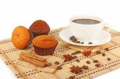 stock photo of testis  - Cup of hot testy coffee with spice and muffins on wooden mat food photo - JPG