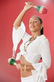 Studio shot of a female Dominican teenager with maracas