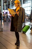Young Traveler Tourist Woman Holding Paper Map, Search Route, At International Airport Or Train Stat poster