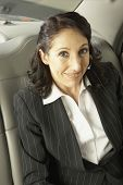 Businesswoman n the backseat of a car