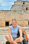 Backpacker girl visiting Uxmal, Mexico - Mayan ruins