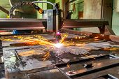 A Plasma Cutting Machine Cuts Large And Thick Steel Sheets. Lots Of Bright Red Sparks And Smoke. poster