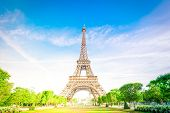 Paris Eiffel Tower Over Green Grass Lane And Trees In Paris, France. Eiffel Tower Is One Of The Most poster