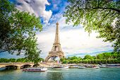 Paris Famous Landmarks. Eiffel Tower Iwith Green Tree Over River, Paris France, Toned poster