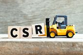 Toy Forklift Hold Letter Block R To Complete Word Csr (abbreviation Of Corporate Social Responsibili poster