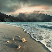 Landscape With Beautiful Sea And Majestic Sunrise Over Mountains, Waves And Sand Coastline. Vintage  poster