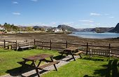 foto of carron  - Picnic tables with the village of Plockton and Loch Carron in the background - JPG