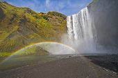 Full Rainbow In The Mist Of Colorful Skogafoss Waterfall In Iceland poster