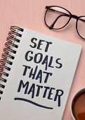 Set goals that matter  inspirational advice or reminder - handwriting in a notebook, smart goals set poster