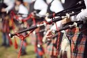 Scottish bagpipe marching band close up on bagpipes poster
