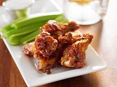 stock photo of chicken wings  - bbq buffalo wings with celery and ranch - JPG