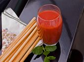 Tomato Juice With Breadsticks And Mint.