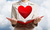Beautiful Woman Showing Red Heart Above Opened Notebook. Love And Tenderness, Valentines Holiday And poster