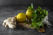 Ginger, Lemons And Mint Leaves On Dark Background. Ginger Tea, Drink Ingredients, Cold And Autumn. poster