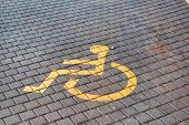 Post With Disabled Parking Space And Sign In Front Of Parking Bay In Car Park / Marked Parking For P poster