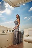 Gorgeous Sexy Woman With Long Straight Brown Hair In Silver Shining Dress Standing At Luxury Yacht O poster