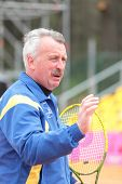 KHARKIV, UKRAINE - APRIL 20: Ukrainian team captain Igor Dernovskyi watch training during Fed Cup Ti