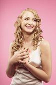 Studio shot of woman with hands over heart
