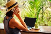 Technology And Travel. Working Outdoors. Freelance Concept. Pretty Young Woman In Hat Using Laptop I poster