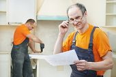 Portrait of Craftsman carpenter at kitchen cabinet installation service work