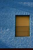 Old Yellow Window In Light Blue Wall