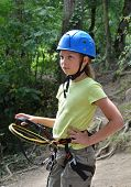 stock photo of parkour  - Preteen girl is wearing on the outfit for rope parkour - JPG