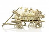 Old fashioned wooden handcart with bags of straw and potatoes