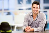 stock photo of entrepreneur  - Handsome business man smiling at the office - JPG