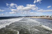 Clear winter sky and windy surf at famous Venice beach in Los Angeles, California USA.