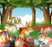 Illustration of a group of bunnies and easter eggs on a white background