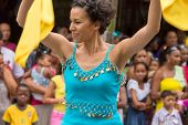 Victoria, Seychelles - February 9, 2013:  A Young Woman In Blue Top Dancing With Yellow Shawls  On S