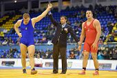 KIEV, UKRAINE - FEBRUARY 16: Khotsianivskyi, Ukraine win the match with Ligeti, Hungary during International freestyle wrestling and woman wrestling tournament in Kiev, Ukraine on February 16, 2013