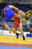 KIEV, UKRAINE - FEBRUARY 16: Match between Zasieiev, Ukraine, blue, and Modzmanashvili, Georgia during XIX International freestyle wrestling tournament in Kiev, Ukraine on February 16, 2013