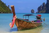 Long tailed boat Ruea Hang Yao on the beach at Holidays sunny tranquil paradise beach on Phi Phi island