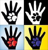 Konzept-Abbildung von Menschenhand Silhouette hält die Pfote einen Hund oder eine Katze